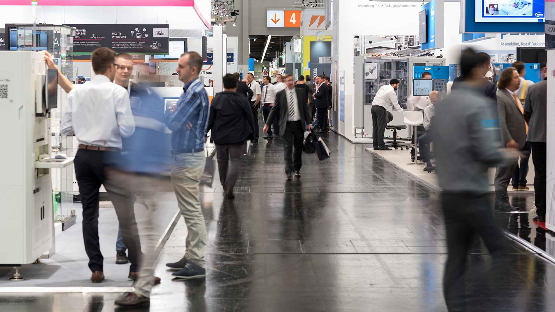 Trade fair atmosphere in hall 4A, including ASYS Automatisierungssysteme GmbH, axiss GmbH and more