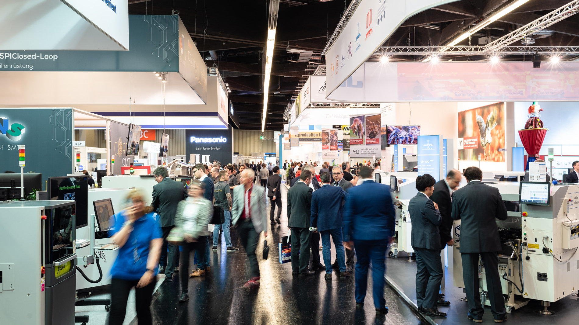 Trade fair atmosphere in hall 4: Panasonic Industry Europe GmbH, JUKI Automation Systems GmbH, and more