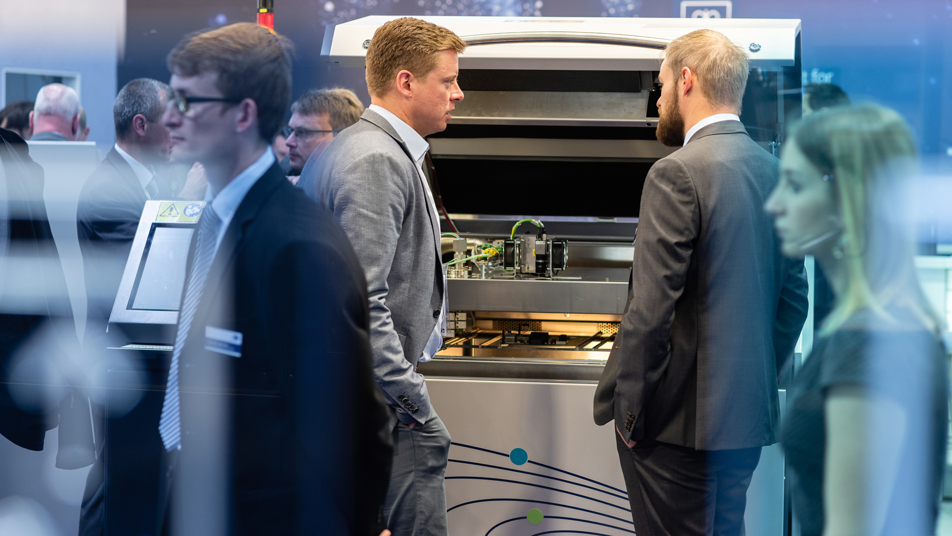 Conversation at the booth of Rehm Thermal Systems GmbH
